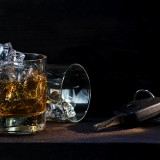 whiskey glasses with ice and car keys on dark wood, concept  dri