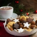 christmas cookies and a coffee cup with hot cocoa, fir tree bran