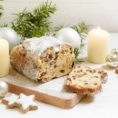 criststollen, typical german christmas cake with candles, bauble